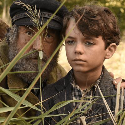 Homme âgé et jeune enfant, personnages du film L'école buissonnière